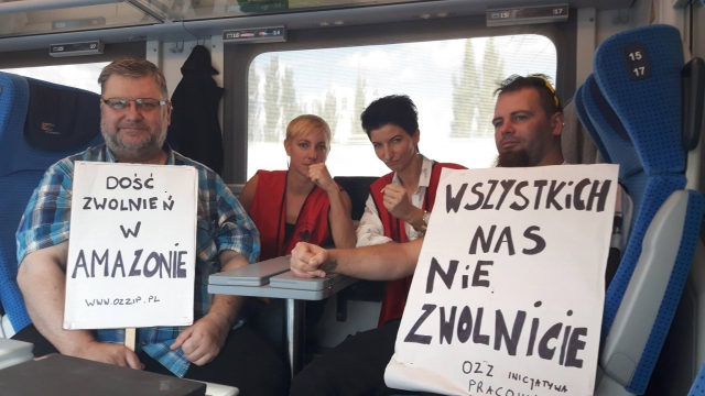 "IP Amazon delegation on the way to a protest in Warsaw, 2016 - banner: ""No to dismissals at Amazon"" and ""You will not fire us all"""